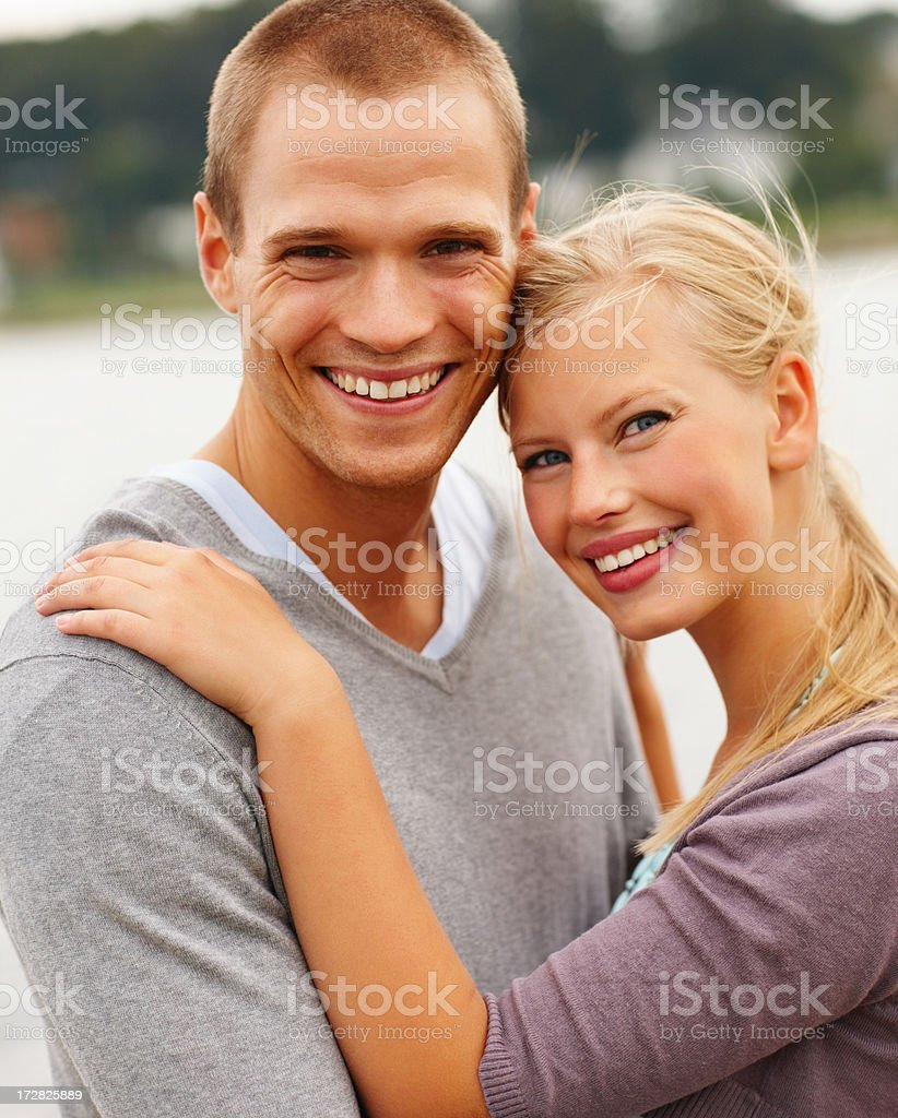Cute couple embracing at the seaside stock photo
