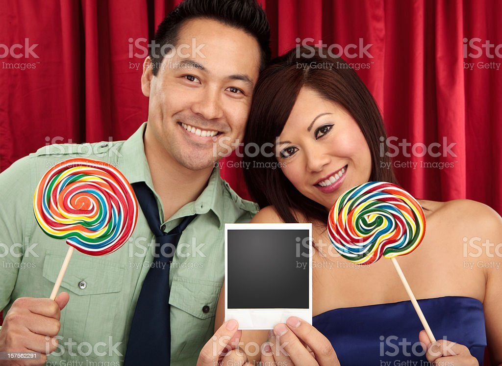 cute couple holding photo frame royalty-free stock photo