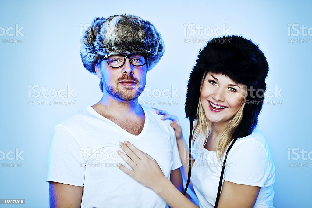 Cute couple in fake fur hats stock photo