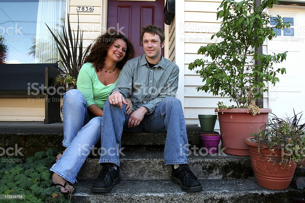 cute couple in front of first house royalty-free stock photo