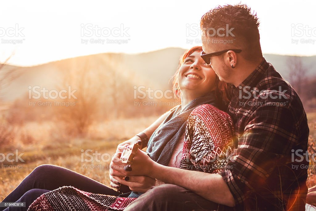 Cute couple playing small guitar  in love and embrace stock photo