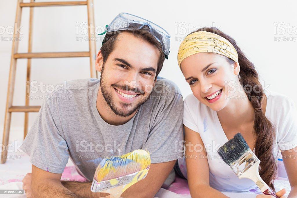 Cute couple redecorating living room stock photo