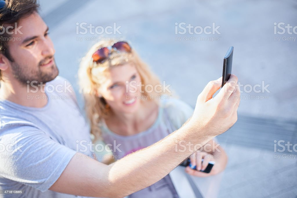 Cute couple taking photo with mobile phone. royalty-free stock photo