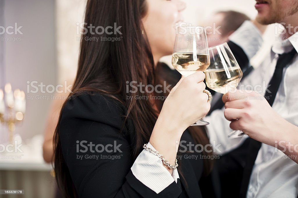 Cute couple toasting at a party royalty-free stock photo