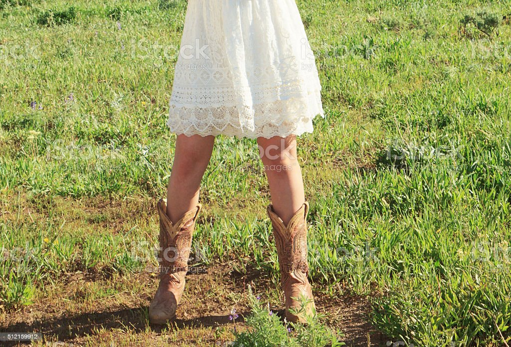 Cute Cowgirl Boots and Lace Dress stock photo