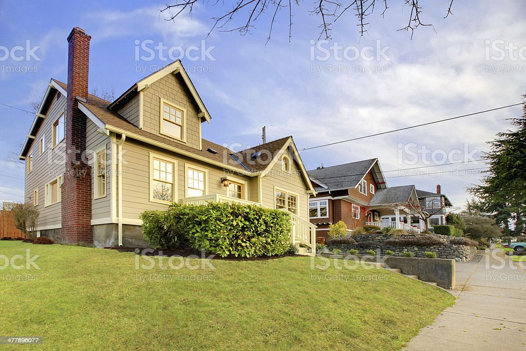 Cute craftsman style home with unique color combination stock photo