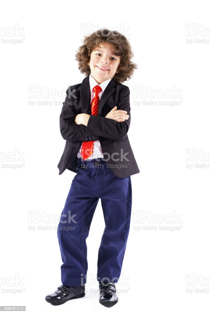 Cute curly-haired boy with his arms folded looking at camera stock photo