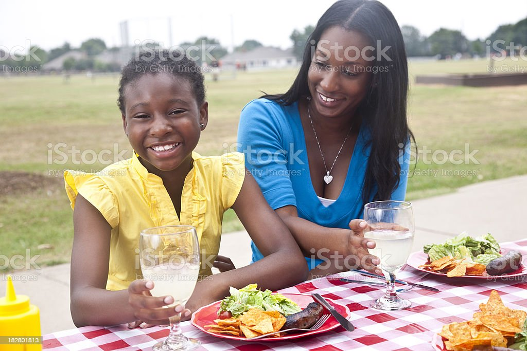 Cute Daughter and Mother At a Picnic Together royalty-free stock photo