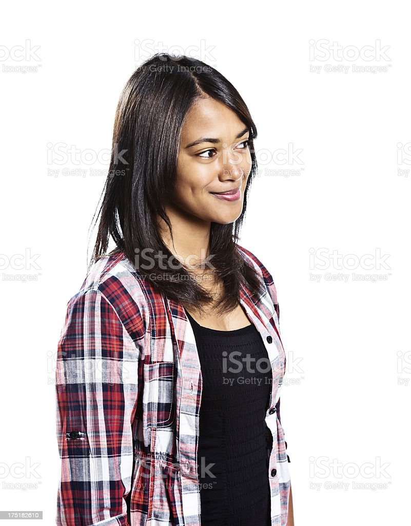 Cute dimpled brunette looks to side smiling gently royalty-free stock photo