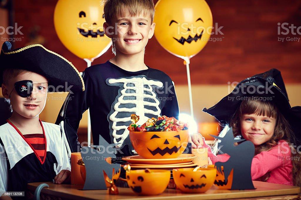 Cute dressed up children celebrating Halloween stock photo