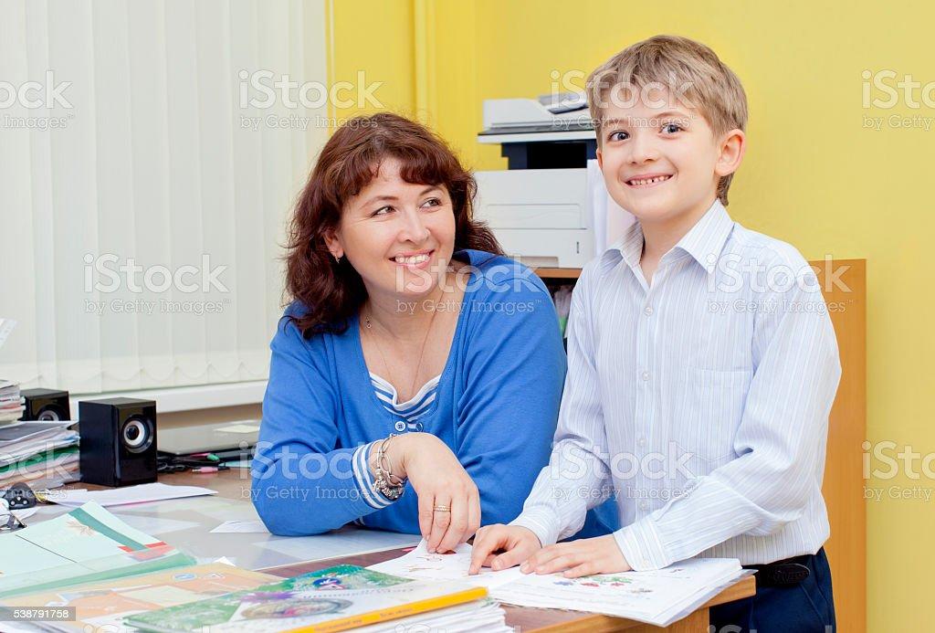 cute elementary school student and teacher stock photo