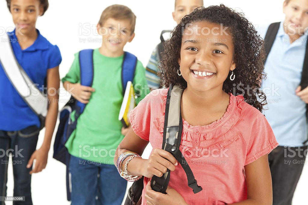 Cute elementary student in front of other students stock photo