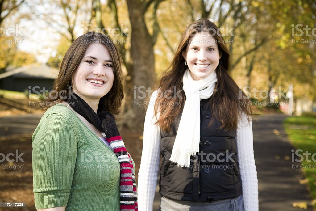 cute fall portrait of two girls royalty-free stock photo