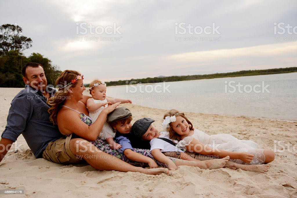 Cute family at the beach stock photo