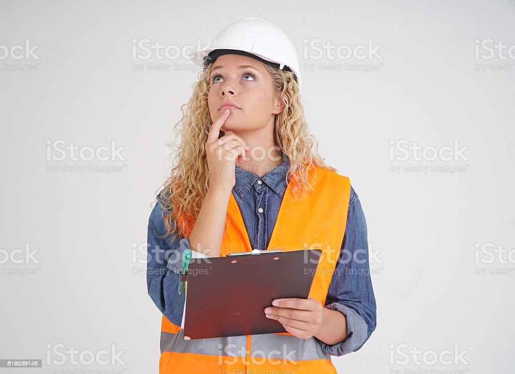 Cute female apprentice engineer pondering her project stock photo