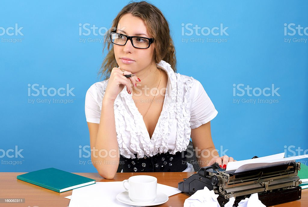 Cute female author with vintage typewriter royalty-free stock photo