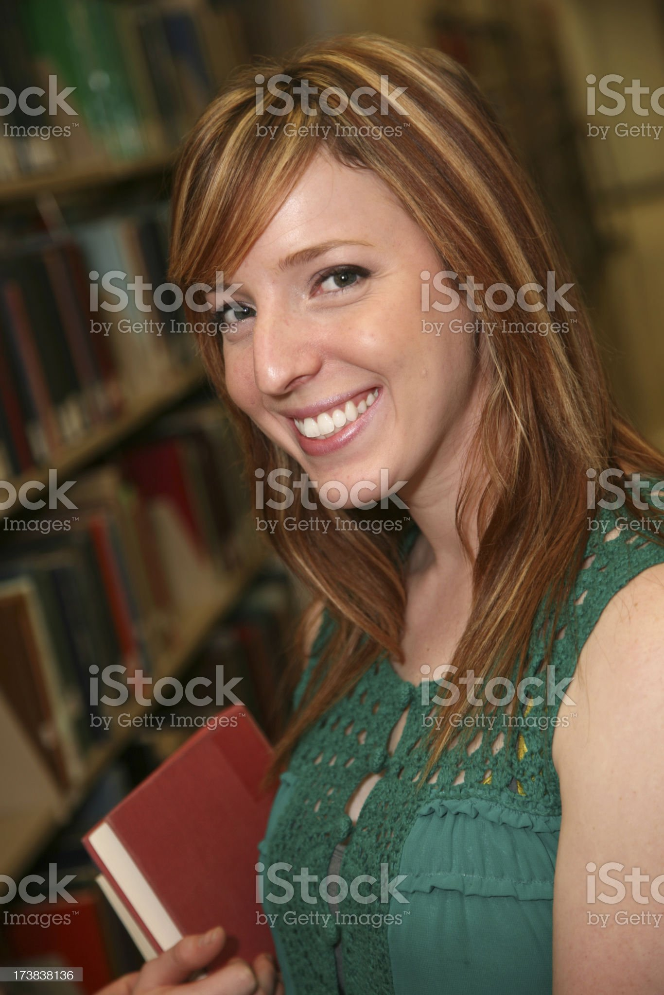 Cute Female College Girl with her books in the Library royalty-free stock photo