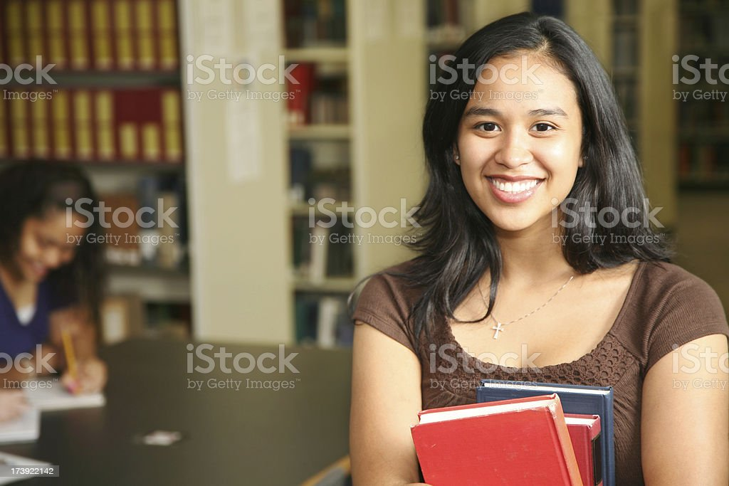 Cute Female College Students in the University Library royalty-free stock photo