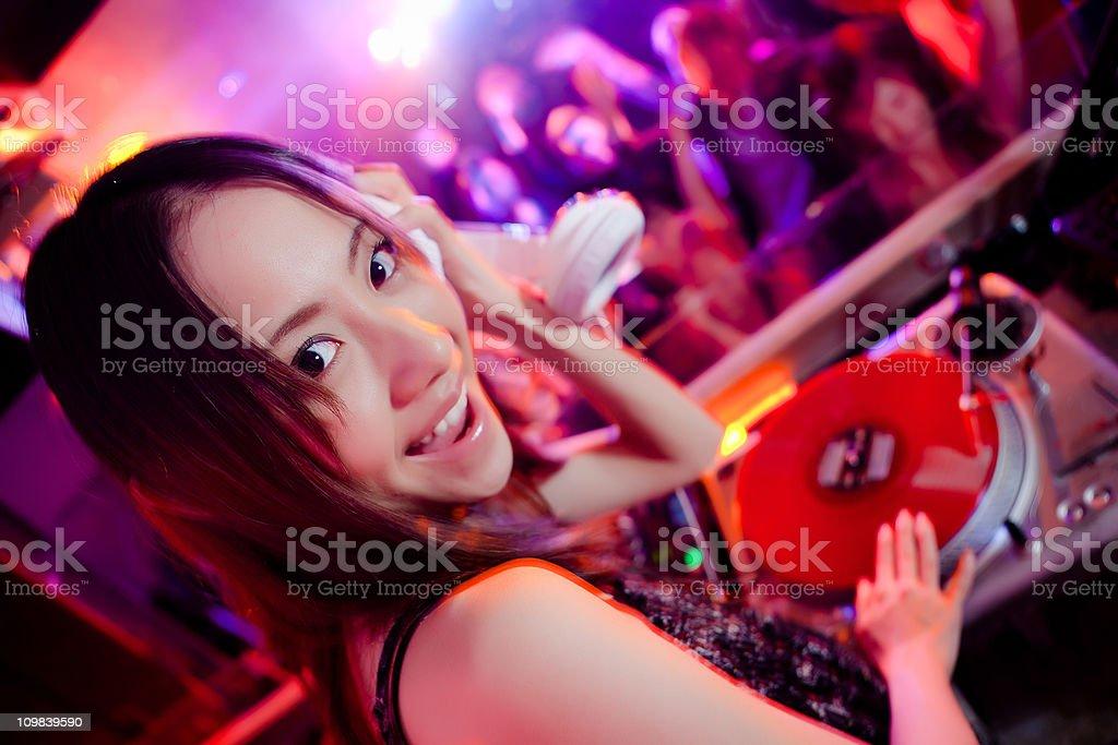 Cute female DJ in a nightclub stock photo