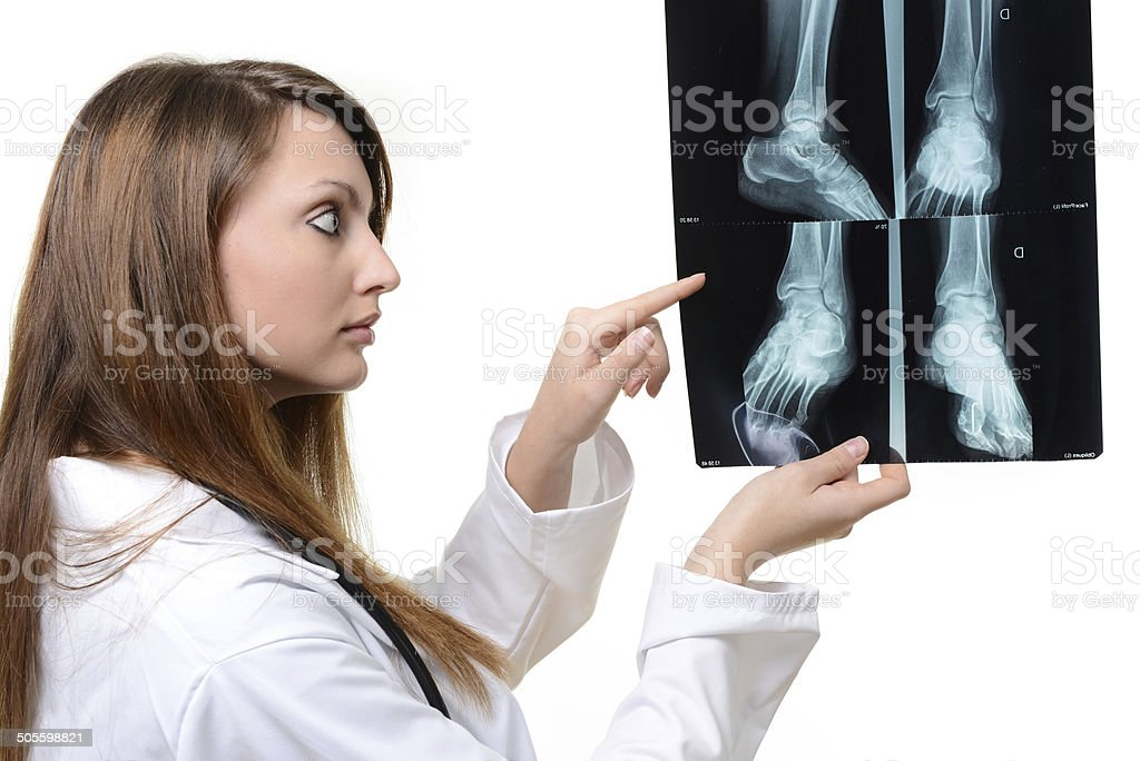 cute female doctor looking at X-ray image royalty-free stock photo