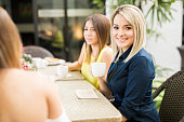 Cute female friends at a cafe
