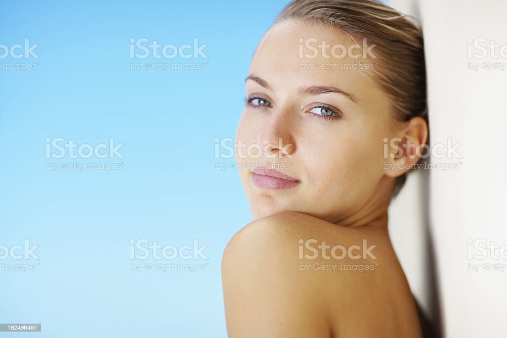 Cute female leaning topless against a wall royalty-free stock photo