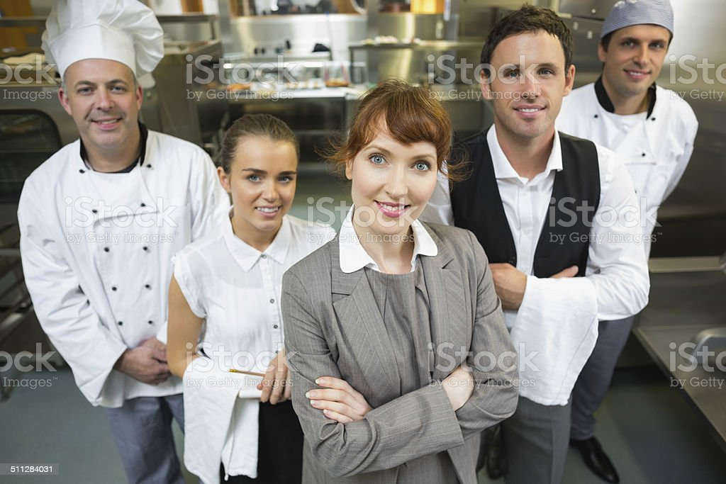 Cute female manager posing with the staff stock photo