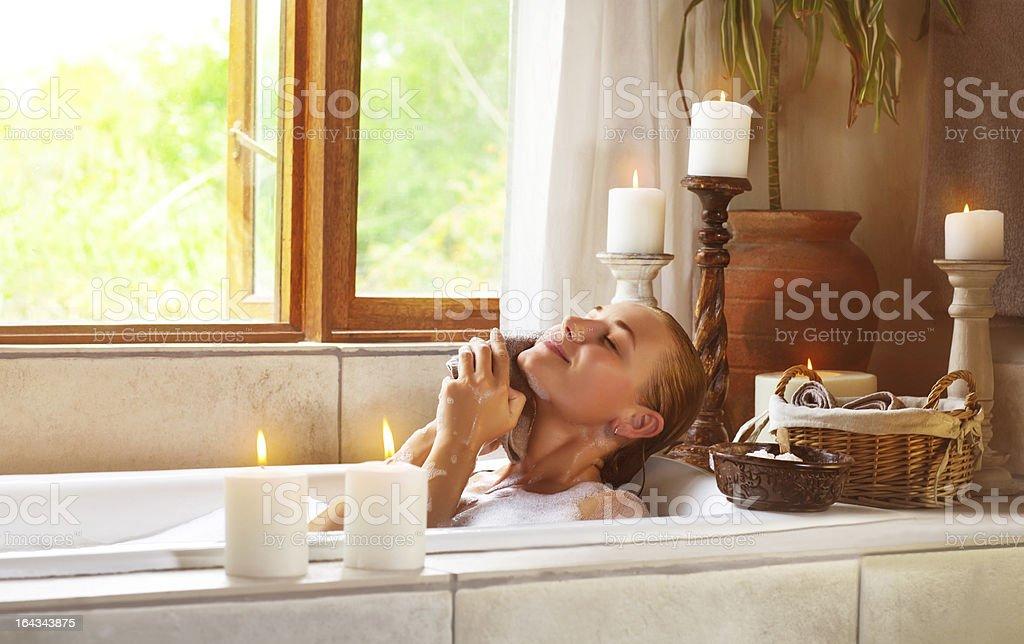 Cute female taking bath royalty-free stock photo