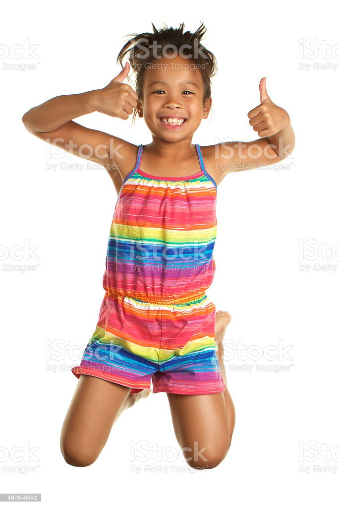 Cute Filipino Girl Jumping on White giving thumbs up stock photo