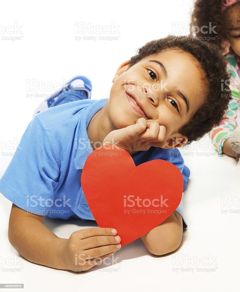 Cute five years old boy with heart symbol stock photo