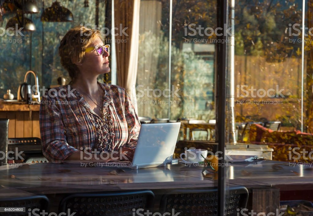 Cute Freelancer Woman wearing glasse looks at the Sun stock photo