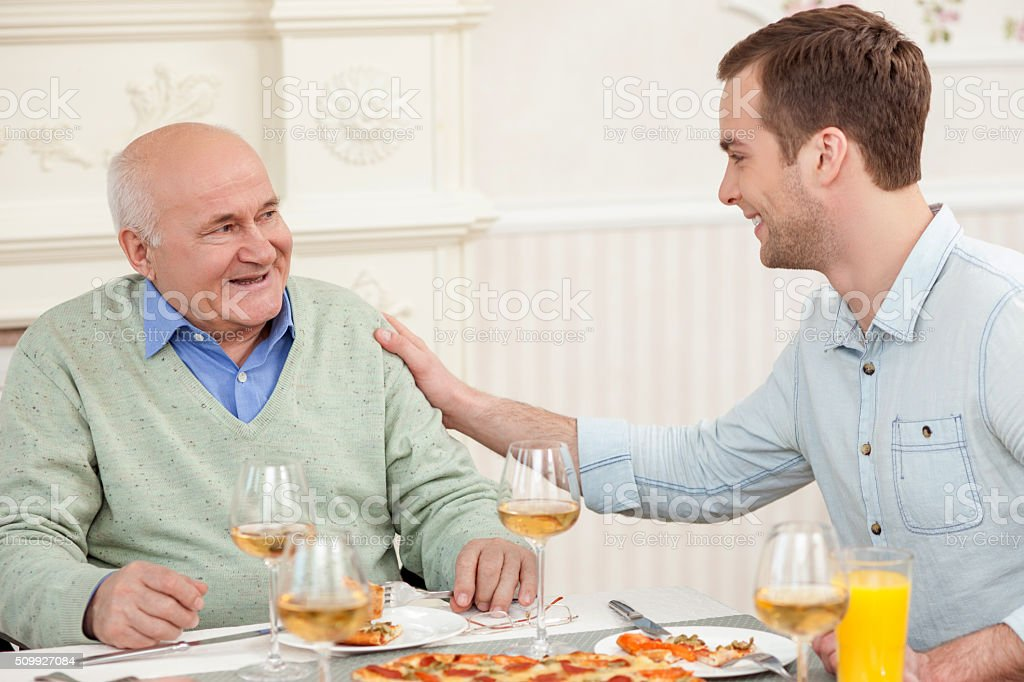 Cute friendly family is dining at home stock photo