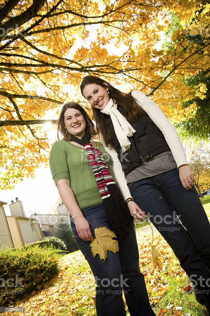 cute friends under backlit trees royalty-free stock photo