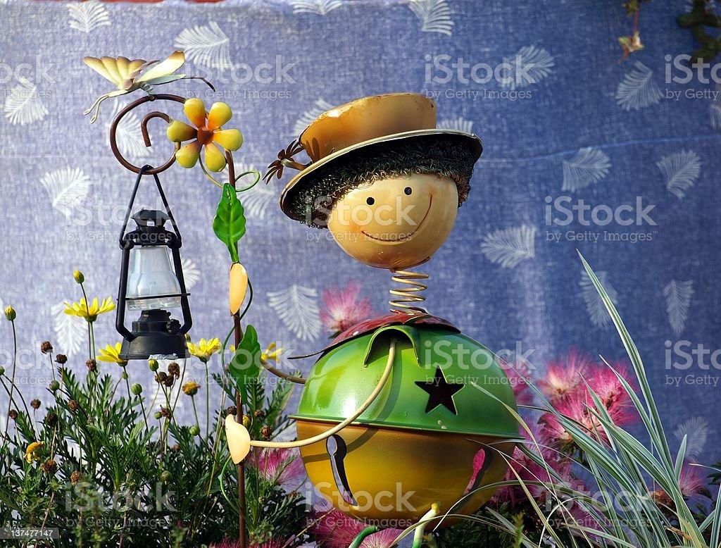 Cute Garden Lantern Figure stock photo