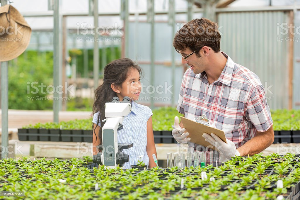 Cute girl and her science teacher on field trip stock photo
