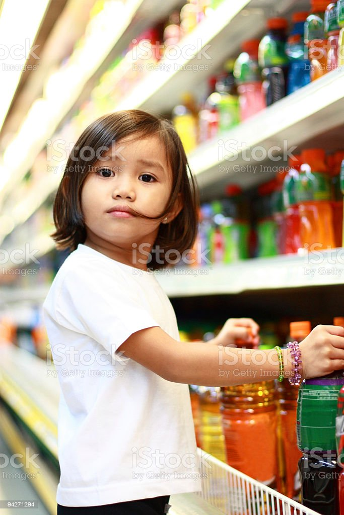 cute girl at the grocery stock photo