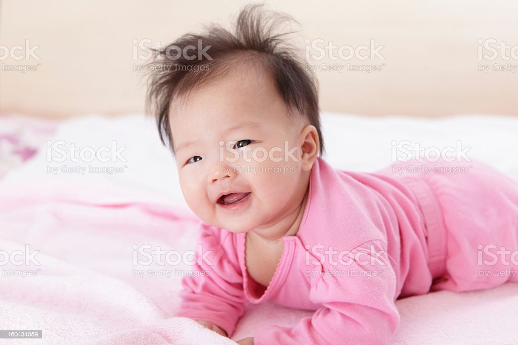 Cute girl baby happy crawl on the bed royalty-free stock photo