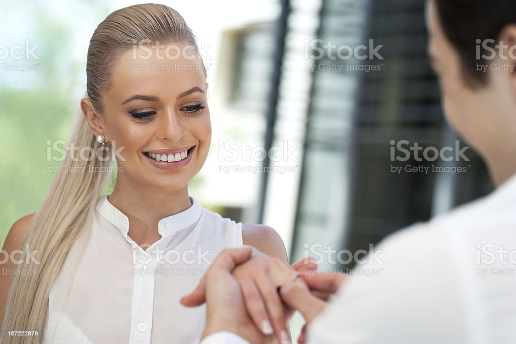 Cute girl being surprised with diamond ring. royalty-free stock photo