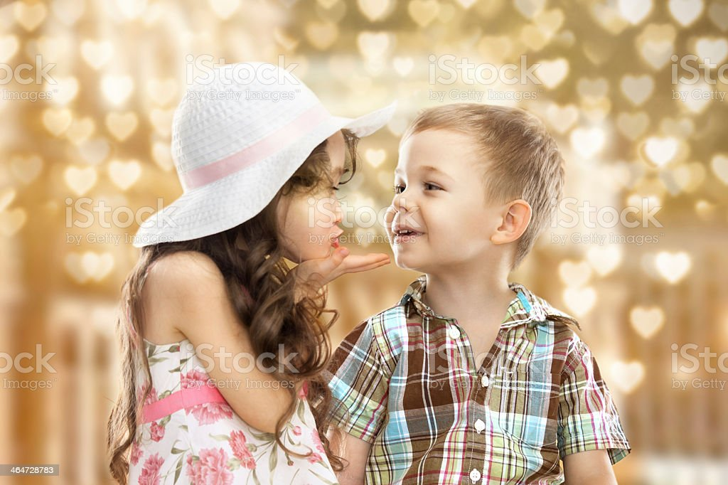Group of cute girls kissing stock little boy gives a flower to cute girl and kisses her stock thecheapjerseys Gallery