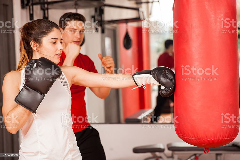 Cute girl boxing with a personal trainer stock photo