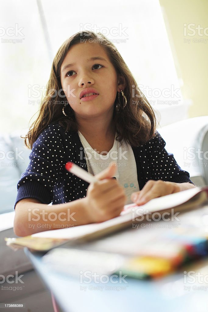 Cute girl coloring royalty-free stock photo