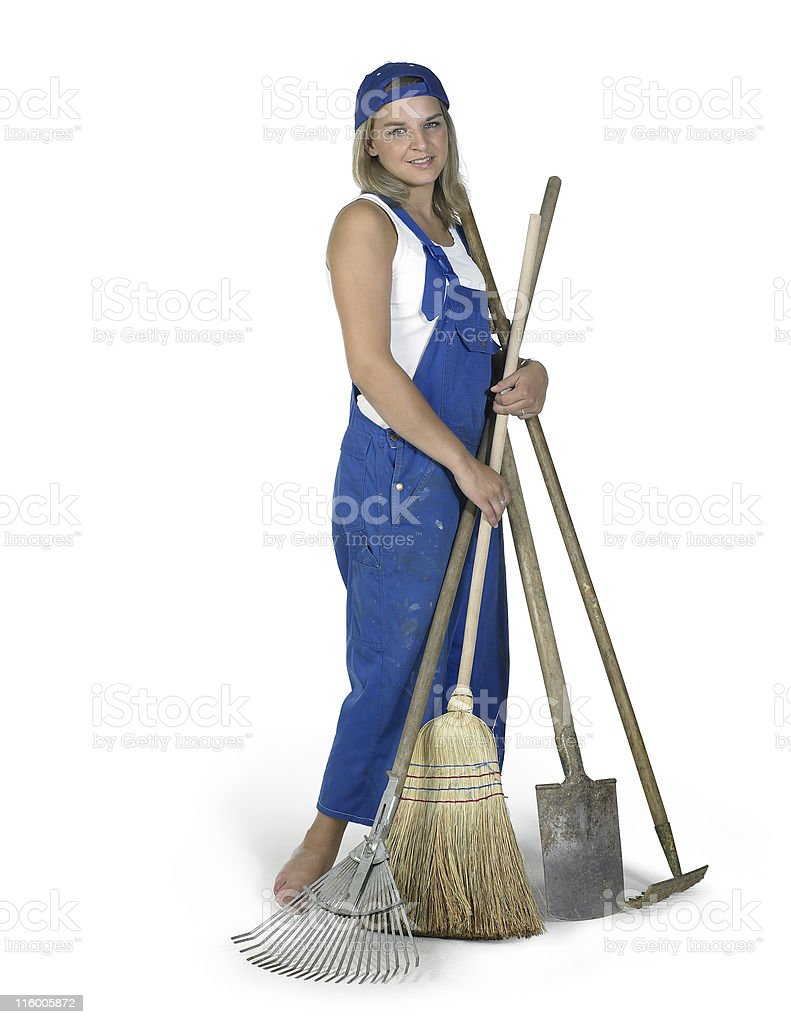 cute girl dressed in workwear with lots of gardening tools royalty-free stock photo