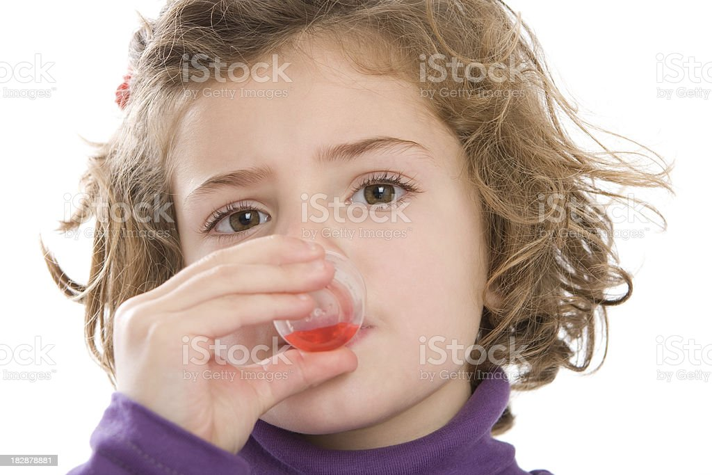 Cute girl drinking her medicine stock photo