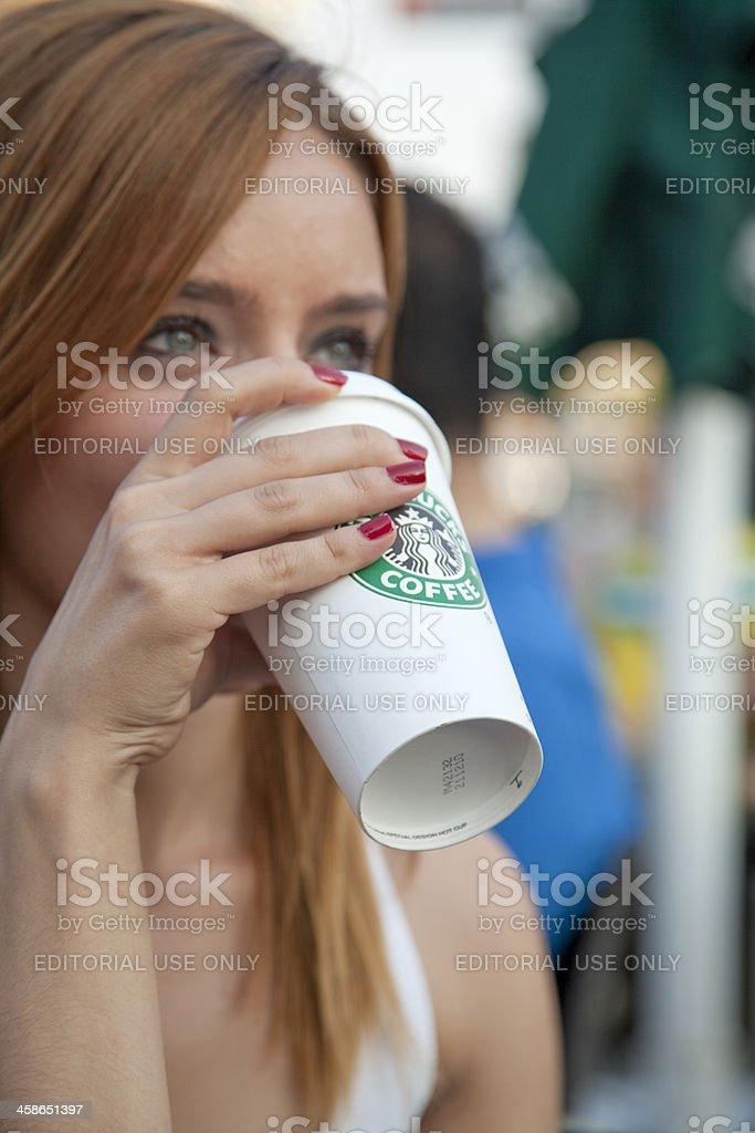 Cute girl drinking Starbucks coffee royalty-free stock photo