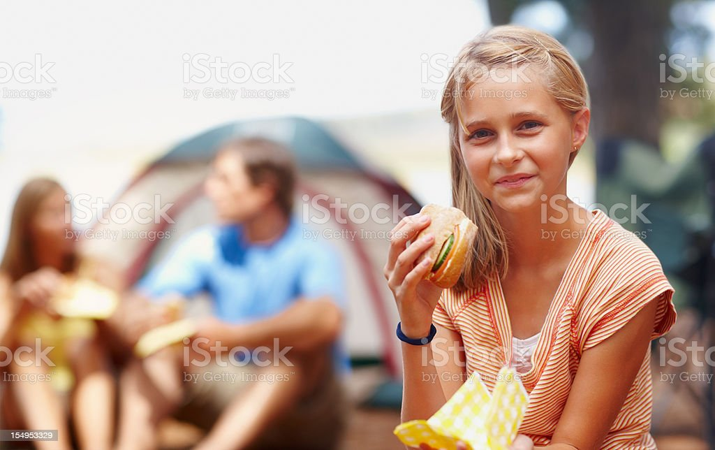 Cute girl eating a sandwich royalty-free stock photo