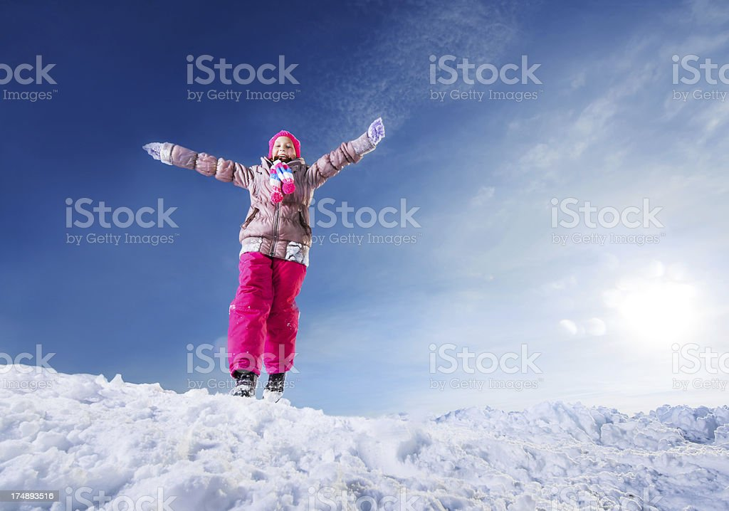 Cute girl enjoying in the snow. royalty-free stock photo