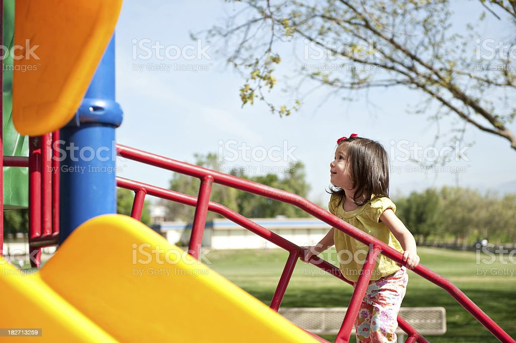 cute girl going up the playground stairs royalty-free stock photo