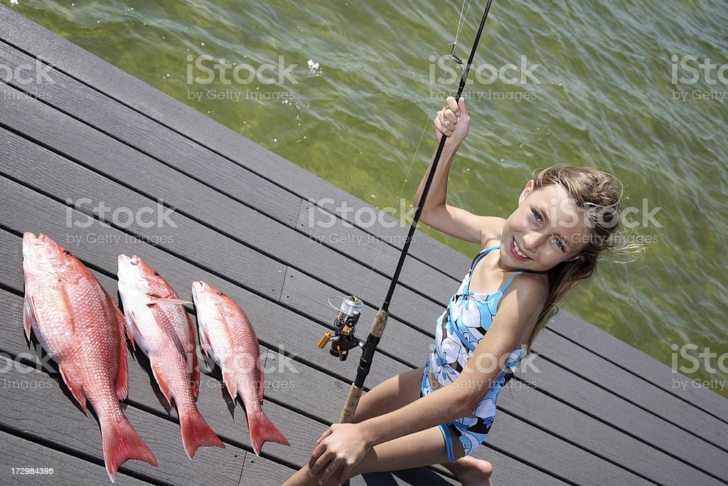 Cute girl has great day fishing for Red snapper stock photo