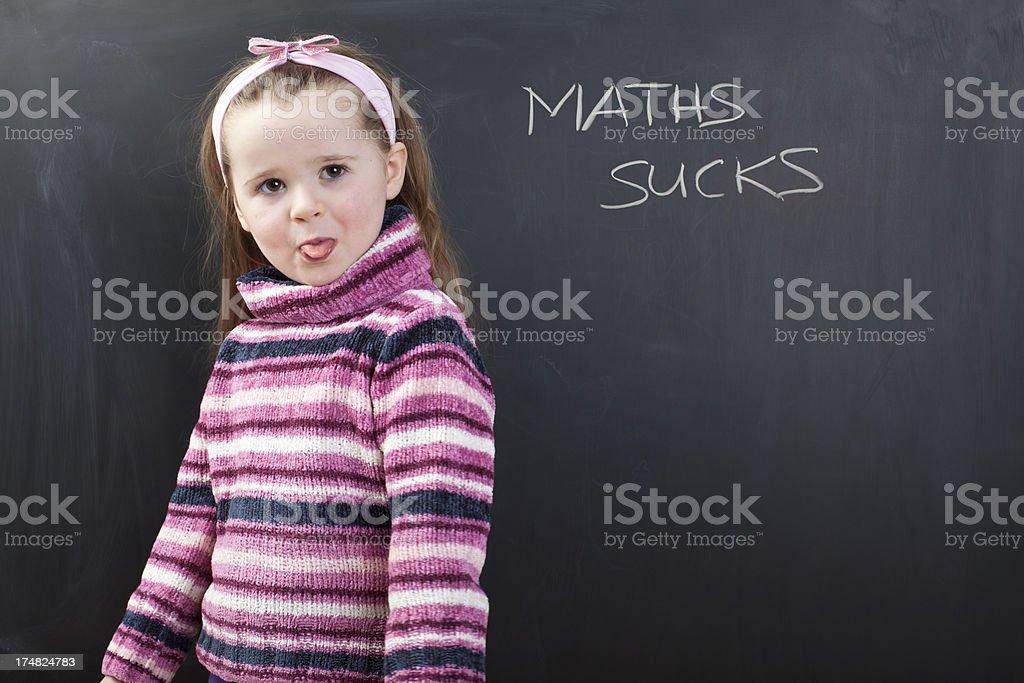 Cute girl hates mathematics royalty-free stock photo