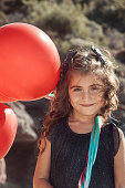 Cute girl having fun with ballons on her birthday